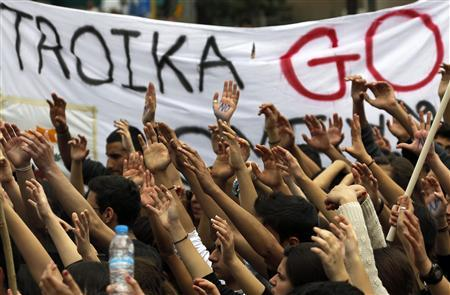 Students take part in an anti-Troika protest outside the Presidencial palace in Nicosia