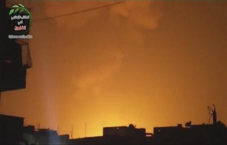 Still image taken from video shows a lit-up sky after an explosion at what Syrian state television reported was a military research centre in Damascus